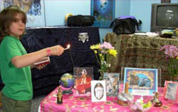 A child lighting the candles for the ceremony, April 2007.
